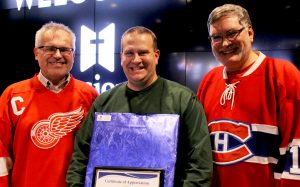 Steve Johnson, centre, celebrating 15 years of service