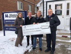 Drewlo Holdings cheque presentation in front of Quintin Warner House