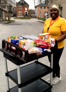 Rotholme Family Shelter staff person collecting food donations in the parking lot